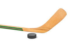 Ice hockey stick and puck Stock Images
