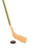 Ice hockey stick and puck Royalty Free Stock Photography