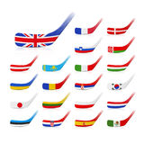 Ice hockey sticks with flags Stock Images