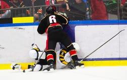 Ice hockey tackle Stock Photos