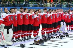 Ice Hockey 2017 World Championship Div 1 in Kyiv, Ukraine. KYIV, UKRAINE - APRIL 25, 2017: Austrian players listen to National anthem after the IIHF 2017 Ice Royalty Free Stock Image