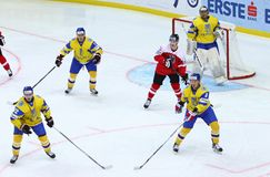 Ice Hockey 2017 World Championship Div 1 in Kyiv, Ukraine. KYIV, UKRAINE - APRIL 25, 2017: Ukrainian ice-hockey players Yellow jersey defend their net during Stock Image