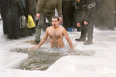 Ice-hole bathing. Russians used to bath in ice-hole  on Epiphany day, after water is blessed by a priest. this shot was taken in Siberian village Kornilovo near Royalty Free Stock Photo