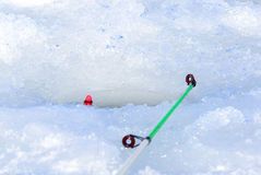 Ice hole for fishing. On the lake Royalty Free Stock Image