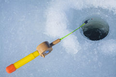 Ice-hole and fishing rod for winter fishing Stock Image