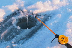 Ice-hole and fishing tackle Royalty Free Stock Images