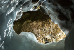 Ice Hole in the grotto. Stock Photos