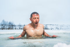 Ice hole swimming. Young man swimming in the winter lake in the ice hole Royalty Free Stock Photos