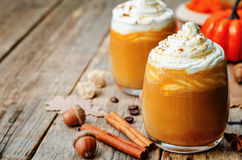 Ice honey pumpkin spice latte with whipped cream Royalty Free Stock Photos