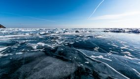 Ice horizont of lake Baikal. Ice of lake Baikal with a view on the frozen ice, winter 2018, Siberia, Russia Royalty Free Stock Photo
