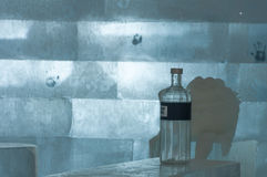 Ice hotel bar with a bottle of spirit Royalty Free Stock Photo