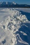 Ice hummocks of Lake Baikal and Holy Nose Peninsula. Royalty Free Stock Photos