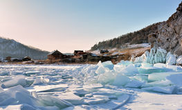 Ice hummocks on Lake Baikal near a small village Stock Images