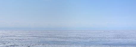 Ice hummocks on lake Baikal shore. Siberia winter landscape view. Snow-covered ice of the lake. Panorama. Stock Image