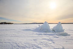 Ice hummocks on winter coast of Barents sea Royalty Free Stock Photography