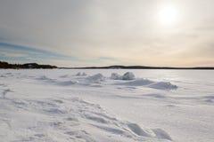 Ice hummocks on winter coast Stock Images
