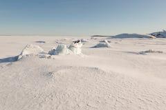 Ice hummocks on winter coast Royalty Free Stock Photos
