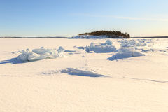 Ice hummocks on winter coast Royalty Free Stock Images