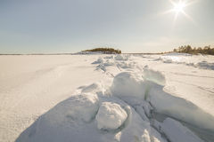Ice hummocks on winter coast Stock Photos
