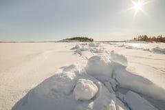 Ice hummocks on winter coast Stock Photos