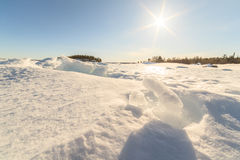 Ice hummocks on winter coast Royalty Free Stock Image