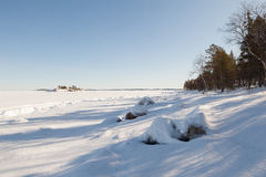 Ice hummocks on winter coast Stock Photo