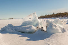 Ice hummocks on winter coast Stock Image