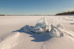 Ice hummocks on winter coast Royalty Free Stock Photography