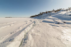 Ice hummocks on winter coast Royalty Free Stock Photo