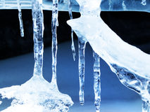 Ice icicle formations. Winter ice cold blue icicle crystal formations Royalty Free Stock Photo