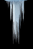 Ice icicles. On a black background stock photography