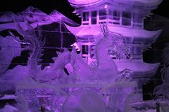 Ice installation. The dragon and the Chinese temple royalty free stock photography