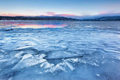 Ice Jam, Payette Lake, McCall. Sunrise on Payette Lake in McCall, Idaho adds a little color to an otherwise greyscale landscape Stock Photography