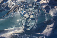 Ice Joker. A jester's mask carved from ice Royalty Free Stock Photo