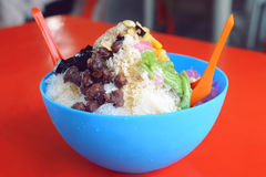 Ice kacang or ais kacang (ABC) in Malay language. A colorful Malaysian dessert made of shaved ice, beans and colorful jelly royalty free stock images