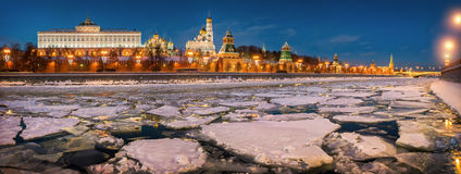 Ice and Kremlin. Ice floes on the Moscow River and the Kremlin in the evening illumination of lamps Royalty Free Stock Images