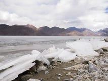 Ice lake in mountain range Stock Photos
