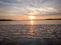 Ice Lake in Pure Michigan. Cass Lake ice melting in the spring during sunset. Enjoyed and captured in April 2017 in Keego Harbor, Michigan Stock Photography