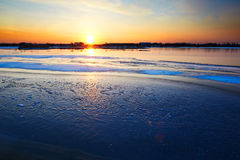 The ice lake and sunset glow Stock Images