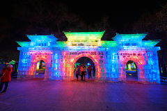 The ice lamps - city gate and visitors. The photo was taken in Zhaolin park Harbin city Heilongjiang province,China royalty free stock photos