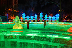 The ice lamps and visitors. The photo was taken in Zhaolin park Harbin city Heilongjiang province,China royalty free stock photo