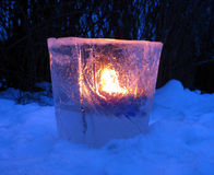 Ice lantern. An ice lantern with a fire burning inside Stock Images