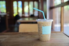 Iced latte coffee. On wooden table stock photos