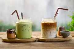 Ice latte coffee and matcha green tea. On wood table Stock Photos