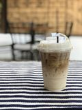 The ice latte on the Tablecloth. In the coffee  shop where locate in Chiangmai Thailand Stock Image