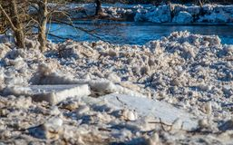 Ice left on a rivers bank in spring Stock Photo
