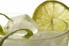 Ice and lemon cocktail. Cocktail with ice and lemon with lime peel royalty free stock images