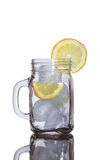 Ice and lemon in a jar Stock Image
