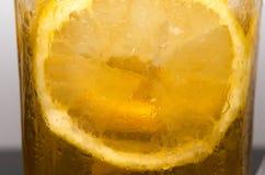 Ice lemon tea closeup. stock photos