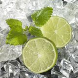Ice with Lime Wedges. Studio photography of some sliced lemon fruits and lots of ice cubes royalty free stock photos